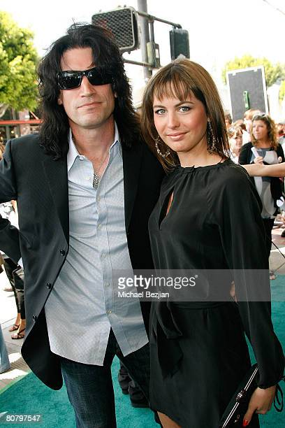 Recording artist Tommy Thayer and his wife Amber attend 'A Plumm Summer' Premiere at the Mann Bruin Theater on April 19 2008 in Westwood California