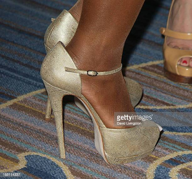 Recording artist Toni Braxton attends the 10th Annual Lupus LA Hollywood Bag Ladies Luncheon at the Beverly Wilshire Four Seasons Hotel on November 1...