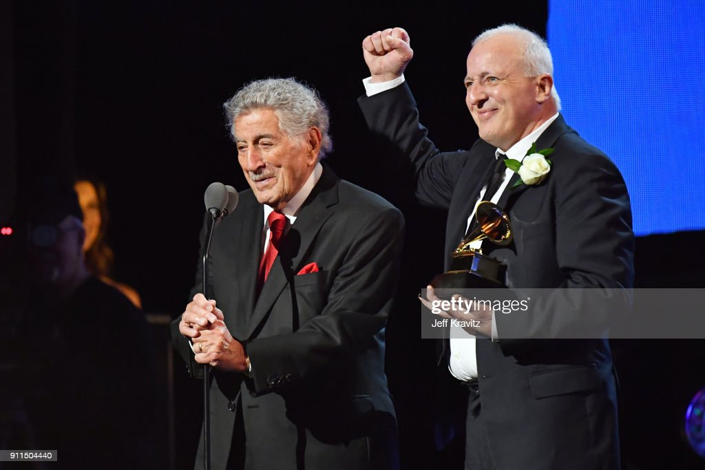 Recording artist Tony Bennett (L) and audio engineer Dae Bennett accept the award for Best Traditional Pop Vocal Album the premiere ceremony during the 60th Annual GRAMMY Awards at Madison Square Garden on January 28, 2018 in New York City.