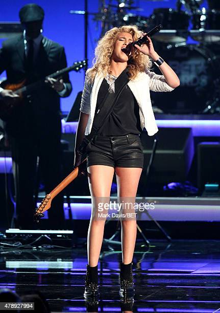 Recording artist Tori Kelly performs onstage during the 2015 BET Awards at the Microsoft Theater on June 28 2015 in Los Angeles California