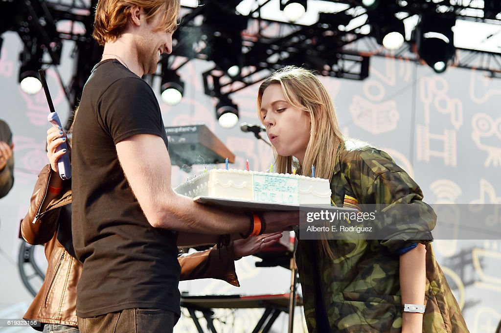 Recording artist Tove Lo blows out her birthday candles onstage during Entertainment Weekly's PopFest at The Reef on October 30, 2016 in Los Angeles, California.
