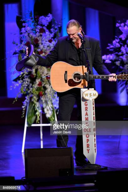 Recording Artist Trace Adkins removes his hat in honor of his friend Troy Gentry as he performs during the Celebration of Life for Troy Gentry at...