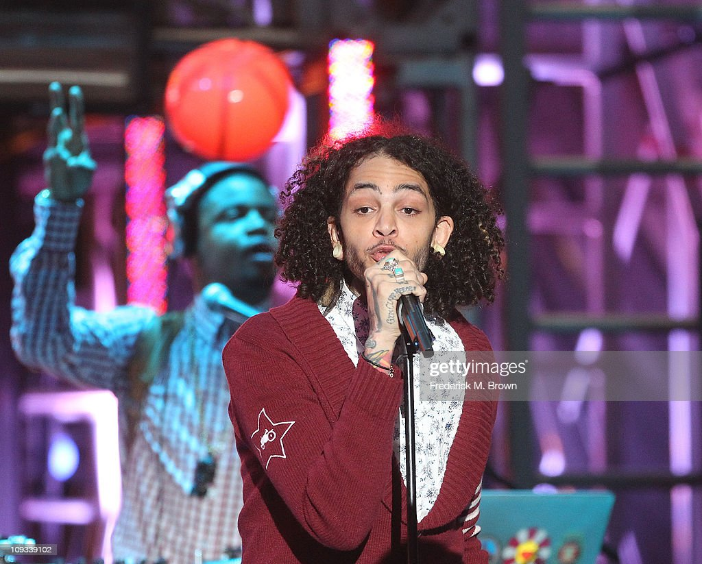 Recording artist Travie McCoy performs during the First Annual Cartoon Network's 'Hall of Game' award show at the Barker Hanger on February 21, 2011 in Santa Monica, California.