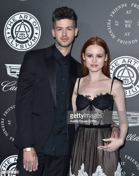 Recording artist Travis Mills and actress Madelaine Petsch arrive at The Art of Elysium's 11th Annual Celebration Heaven at Barker Hangar on January...