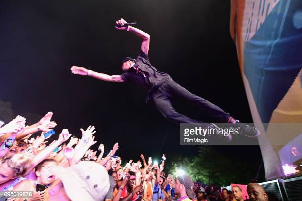 Recording artist Travis Scott jumps into the audience while performing at Which Stage during Day 4 of the 2017 Bonnaroo Arts And Music Festival on...