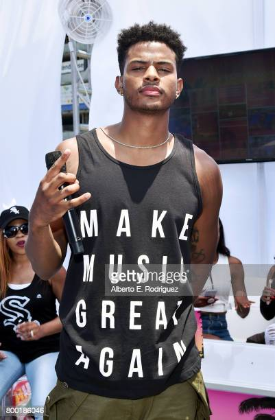 Recording artist Trevor Jackson poses at day one of the Pool Groove sponsored by McDonald's during the 2017 BET Experience at Gilbert Lindsey Plaza...