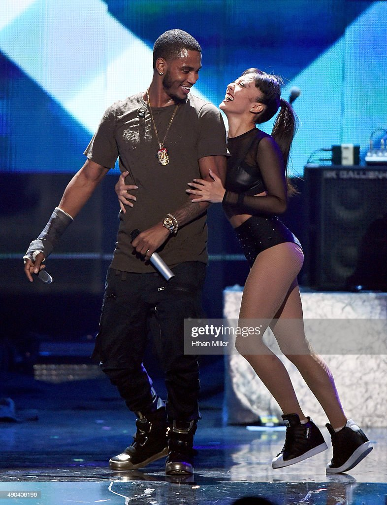 Recording artist Trey Songz (L) performs with a dancer at the 2015 iHeartRadio Music Festival at MGM Grand Garden Arena on September 19, 2015 in Las Vegas, Nevada.