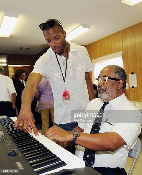 Recording Artist Trombone Shorty Andrews and Preservation Hall Jazz Band member Rickie Monie backstage during the 2012 New Orleans Jazz Heritage...