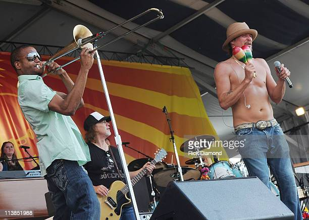 Recording Artist Trombone Shorty joins Singer/Songwriter Kid Rock on stage during the 2011 New Orleans Jazz Heritage Festival Day 7 at The Fair...