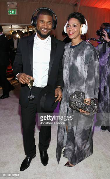 Recording artist Usher and Grace Miguel wearing Samsung Level headphones attend the 8th Annual HEAVEN Gala presented by Art of Elysium and Samsung...