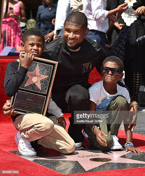 Recording artist Usher and sons Usher Raymond V and Naviyd Ely Raymond attend the ceremony honoring Usher with a star on the Hollywood Walk of Fame...