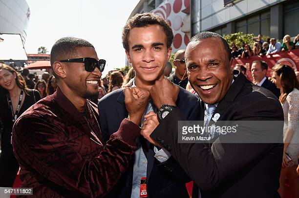 Recording artist Usher Daniel Ray Leonard and Sugar Ray Leonard attend the 2016 ESPYS at Microsoft Theater on July 13 2016 in Los Angeles California