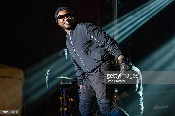 Recording artist Usher performs at the Allstate Sugar Bowl Fan Fest at Jackson Square on December 30 2015 in New Orleans Louisiana