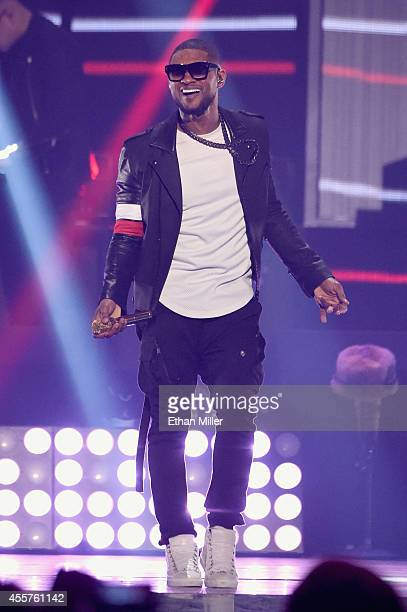 Recording artist Usher performs onstage during the 2014 iHeartRadio Music Festival at the MGM Grand Garden Arena on September 19 2014 in Las Vegas...