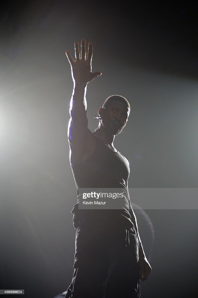 Recording artist Usher performs onstage during 'The UR Experience' tour at Staples Center on November 21, 2014 in Los Angeles, California.