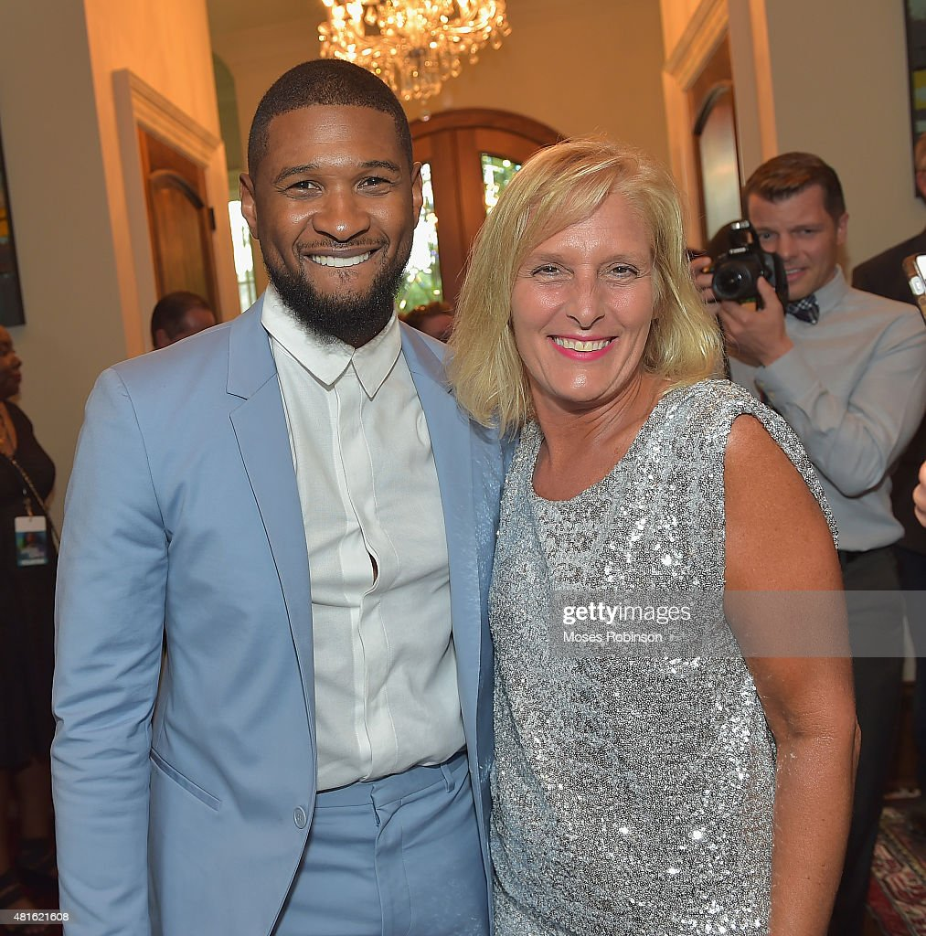 Recording Artist Usher Raymond and Sue Hrib attend Ushers New Look United to Ignite Awards Exclusive VIP Reception on July 22, 2015 in Atlanta, Georgia.