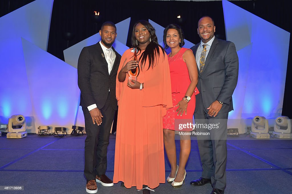 Recording Artist Usher Raymond, Elizabeth Williams, Yvette Cook and Shawn Williams attend Ushers New Look United to Ignite Awards Presidents Circle Luncheon on July 23, 2015 in Atlanta, Georgia.