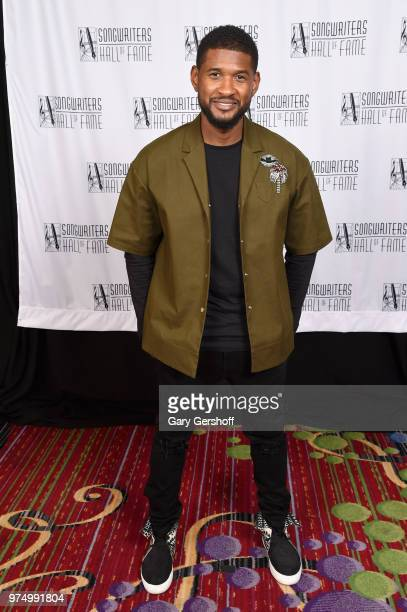Recording artist Usher Raymond poses backstage during the Songwriters Hall of Fame 49th Annual Induction and Awards Dinner at New York Marriott...