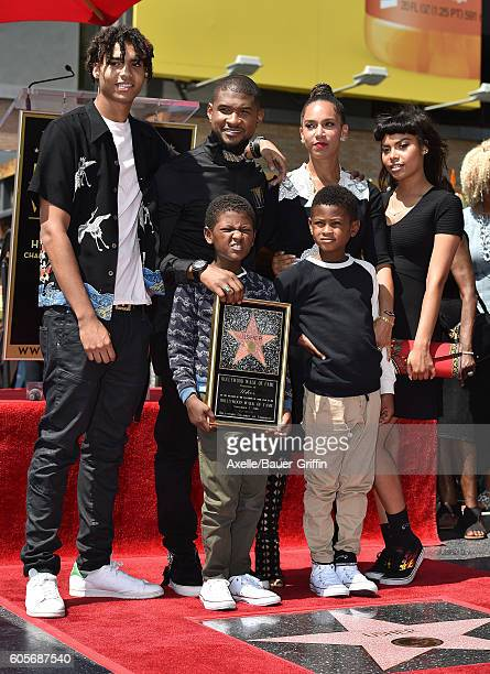 Recording artist Usher sons Usher Raymond V and Naviyd Ely Raymond and wife Grace Miguel attend the ceremony honoring Usher with a star on the...