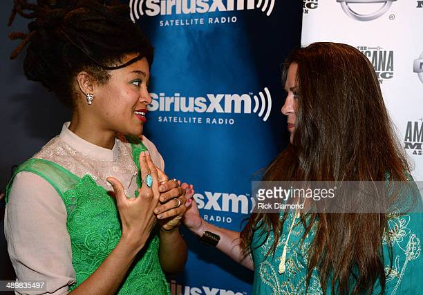 Recording Artist Valerie June chat with Recording Artist Carlene Carter during the Americana Music Association 2014 Award Nominees Announcement at...