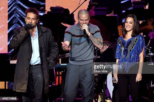 Recording artist Vicentico recording artist Rene Perez Joglar of music group Calle 13 and recording artist Ileana Cabra Joglar perform onstage during...