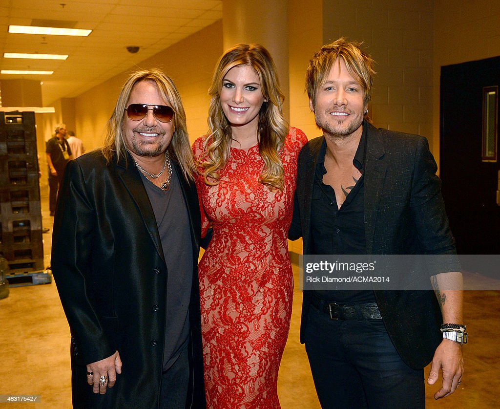 Recording artist Vince Neil, Rain Andreani and recording artist Keith Urban attend the 49th Annual Academy of Country Music Awards at the MGM Grand Garden Arena on April 6, 2014 in Las Vegas, Nevada.