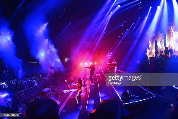 Recording artist Walshy Fire of Major Lazer performs with dancers onstage at What Stage during Day 2 of the 2017 Bonnaroo Arts And Music Festival on...