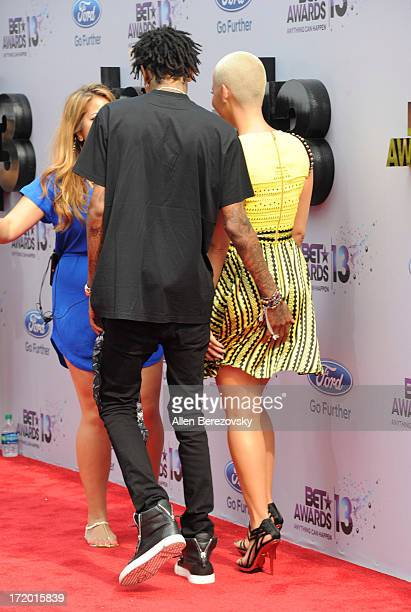 Recording artist Wiz Khalifa and model Amber Rose attend 2013 BET Awards Arrivals at Nokia Plaza LA LIVE on June 30 2013 in Los Angeles California