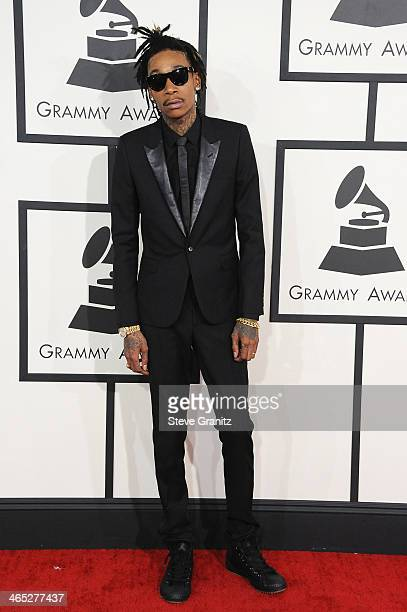 Recording artist Wiz Khalifa featured wearing Converse in support of the GRAMMY Foundation's GRAMMY Camp attends the 56th GRAMMY Awards at Staples...