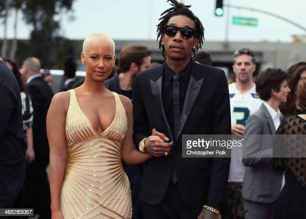 Recording artist Wiz Khalifa featured wearing Converse in support of the GRAMMY Foundation's GRAMMY Camp and model Amber Rose attend the 56th GRAMMY...