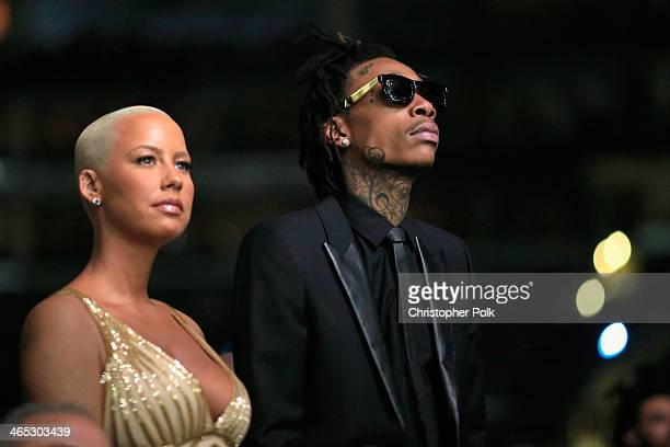Recording artist Wiz Khalifa featured wearing Converse in support of the GRAMMY Foundation's GRAMMY Camp and model Amber Rose attends the 56th GRAMMY...