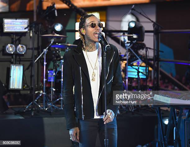 "Recording Artist Wiz Khalifa performs ""See You Again"" on stage with singer Charlie Puth at the Dick Clark's New Year's Rockin' Eve with Ryan Seacrest..."