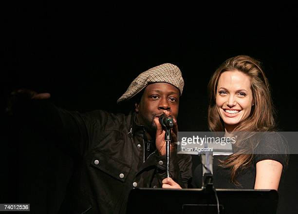 Recording artist Wyclef Jean and actor/director Angelina Jolie speak at the Tribeca Film Institute Screening of the Angelina Jolie directed film 'A...