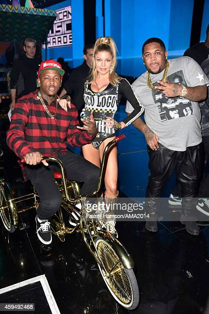 Recording artist YG recording artist Fergie and DJ Mustard attend the 2014 American Music Awards at Nokia Theatre LA Live on November 23 2014 in Los...