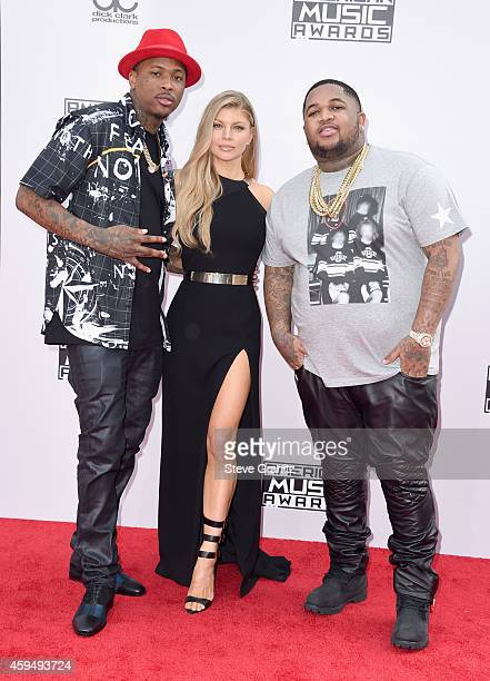 Recording artist YG singer Fergie and DJ Mustard attend the 2014 American Music Awards at Nokia Theatre LA Live on November 23 2014 in Los Angeles...