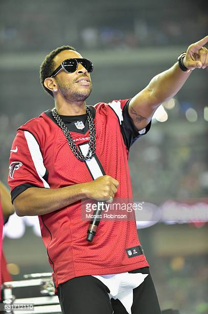 Recording Artist/Actor Chris 'Ludacris' Bridges performs at halftime at the Atlanta Falcons vs Seattle Seahawks game at the Georgia Dome on January...