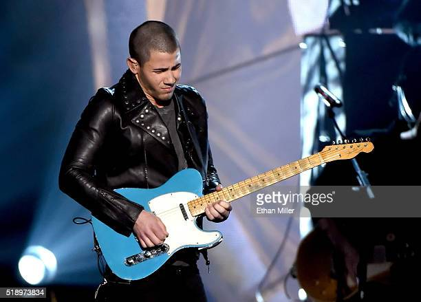Recording artist/actor Nick Jonas performs onstage during the 51st Academy of Country Music Awards at MGM Grand Garden Arena on April 3 2016 in Las...