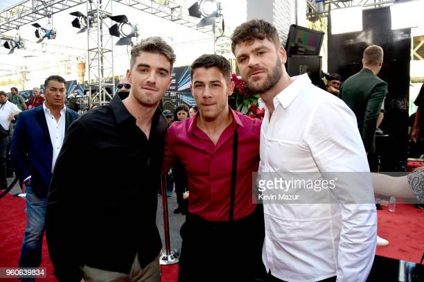 Recording artistactor Nick Jonas with recording artists Andrew Taggart and Alex Pall of The Chainsmokers attend the 2018 Billboard Music Awards at...