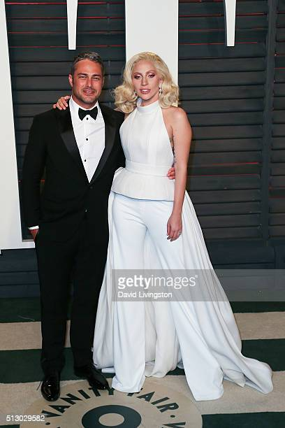 Recording artist/actress Lady Gaga and actor Taylor Kinney arrive at the 2016 Vanity Fair Oscar Party Hosted by Graydon Carter at the Wallis...