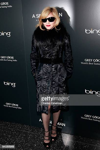 Recording artist/actress Madonna attends a screening of A Single Man hosted by the Cinema Society and Tom Ford at The Museum of Modern Art on...