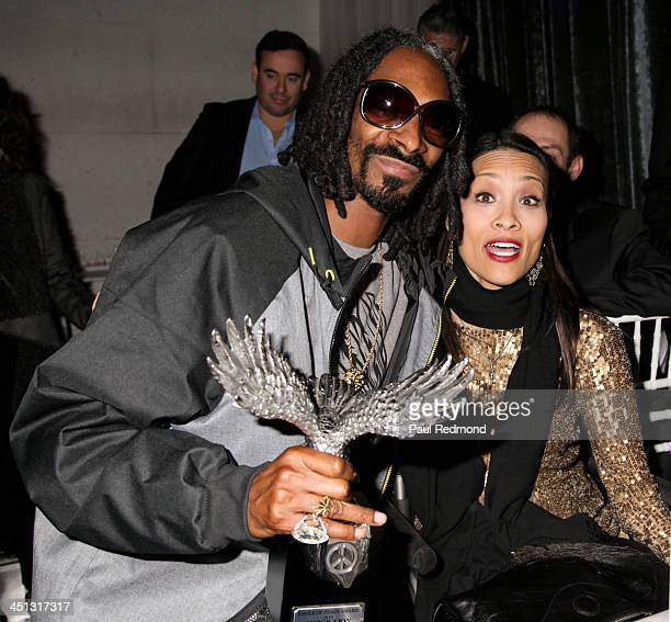 Recording artist/honoree Snoop Lion and TV personality Angela Rockwood of Push Girls attend award at Reloading Life The Art Of Peace Anti Gun...
