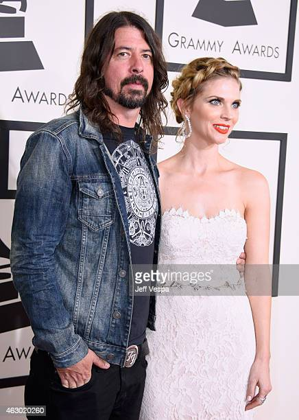Recording artistn Dave Grohl and Jordyn Blum attends The 57th Annual GRAMMY Awards at the STAPLES Center on February 8 2015 in Los Angeles California