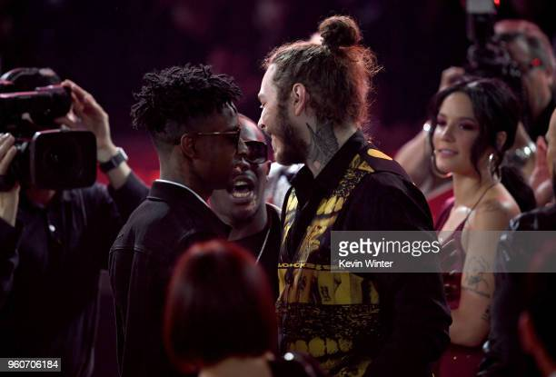 Recording artists 21 Savage and Post Malone attend the 2018 Billboard Music Awards at MGM Grand Garden Arena on May 20 2018 in Las Vegas Nevada