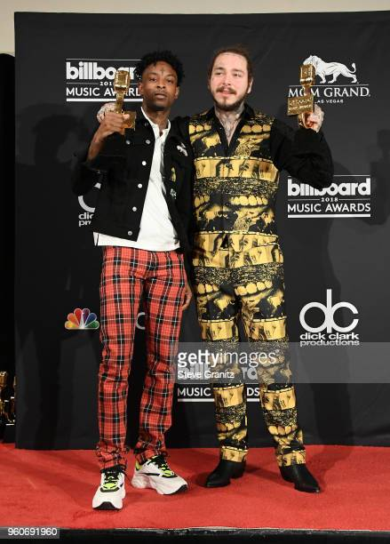Recording artists 21 Savage and Post Malone winners of the Top Rap Song award for 'Rockstar' pose in the press room during the 2018 Billboard Music...