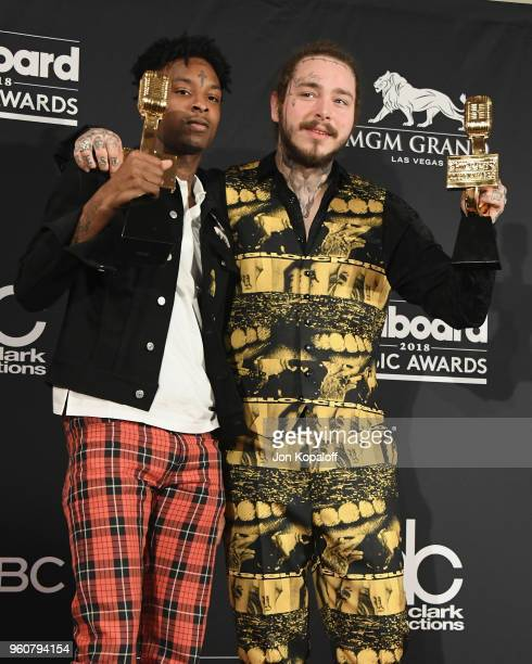 Recording artists 21 Savage and Post Malone winners of the Top Rap Song award for 'Rockstar' pose at the 2018 Billboard Music Awards Press Room at...