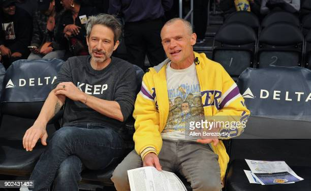 Recording artists Adam Horovitz aka AdRock of the Beastie Boys and Michael Peter Balzary aka Flea of the Red Hot Chili Peppers attend a basketball...