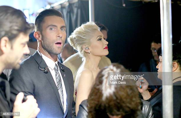 Recording artists Adam Levine and Gwen Stefani prepare backstage at The 57th Annual GRAMMY Awards at STAPLES Center on February 8 2015 in Los Angeles...