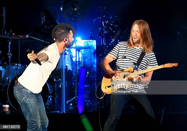 Recording artists Adam Levine and James Valentine of Maroon 5 perform onstage during CBS RADIOs third annual We Can Survive presented by Chrysler at...