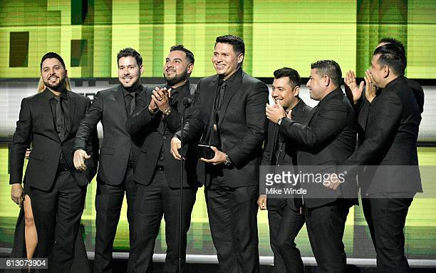 Recording artists Alan Ramirez Sergio Lizarraga and members of Banda MS accept the award for Favorite Duo or Group Regional Mexican onstage during...