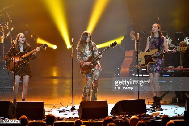 Recording artists Alana Haim Danielle Haim and Este Haim of music group Haimperforms onstage during MusiCares Person of the Year honoring Fleetwood...